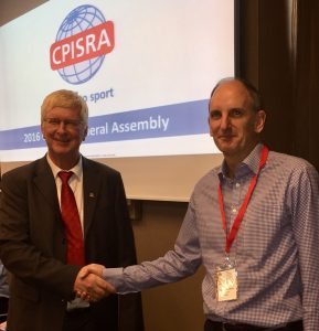 Passing of the Baton. Pictured left, outgoing CPISRA President Mr. Koos Engelbrecht congratulates Mr. Peter Drysdale on his appointment.